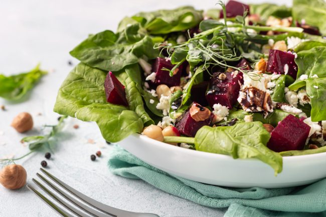 a summery hazelnut salad with roasted beets on top