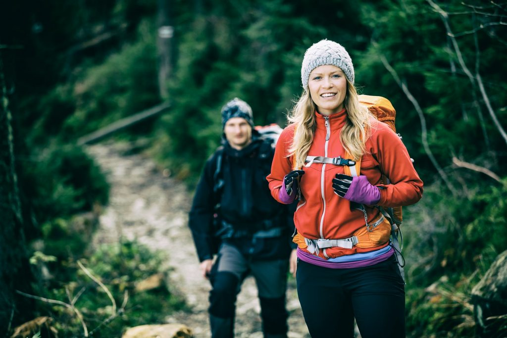 Couple hikers packed hiking snacks for multi day hike